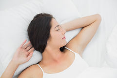 Beautiful woman sleeping in bed with eyes closed Stock Photo