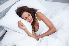 Beautiful woman sleeping on bed at home royalty free stock photography