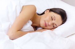 Beautiful woman sleeping in bed stock photo