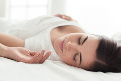 Beautiful woman sleeping in bed Royalty Free Stock Images