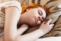 Beautiful woman sleeping in bed Stock Photos