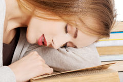 Beautiful woman is sleeping on a book. Royalty Free Stock Photography