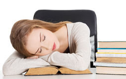 Beautiful woman is sleeping on a book. Stock Photography