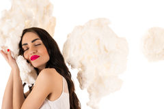 Beautiful woman sleeping on the clouds Royalty Free Stock Photos
