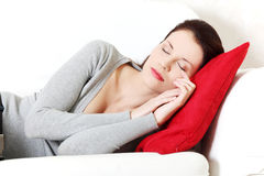 Beautiful woman sleeping on a couch. Royalty Free Stock Photography