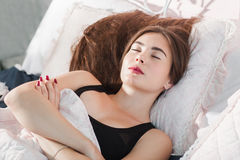 Beautiful woman sleeping with crossed hands Royalty Free Stock Photo