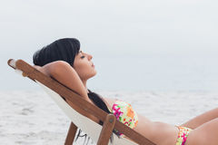 Beautiful woman sleeping on deck chair Royalty Free Stock Photos