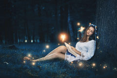 Beautiful woman sleeping among fairies Royalty Free Stock Photography