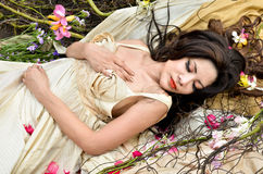 Beautiful woman sleeping with flowers outdoor Stock Images