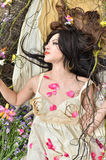 Beautiful woman sleeping with flowers outdoor Royalty Free Stock Photo