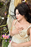 Beautiful woman sleeping with flowers outdoor Royalty Free Stock Images