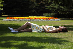 Beautiful woman sleeping in garden summer sun Royalty Free Stock Photos