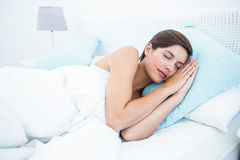 Beautiful woman sleeping in her bed Royalty Free Stock Images