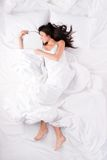 Beautiful woman sleeping and hugging snowboard Royalty Free Stock Photo