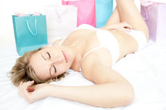 Beautiful woman sleeping lying on her bed Stock Image