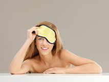Beautiful woman with sleeping mask, smiling Stock Photo