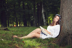 Beautiful woman sleeping peacefully in the forest royalty free stock photo