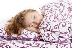 Beautiful woman sleeping and smiles in his sleep in bed Stock Photography