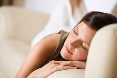 Beautiful woman sleeping on sofa Stock Images