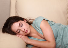 Beautiful woman sleeping on the sofa Royalty Free Stock Images