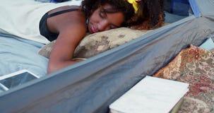 Woman sleeping in the tent 4k. Beautiful woman sleeping in the tent 4k stock video footage