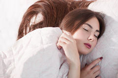 Beautiful woman sleeping under blanket. Covered girl napping, early morning, health care, rest, dreaming concept Royalty Free Stock Photos