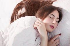 Beautiful woman sleeping under blanket Royalty Free Stock Photos