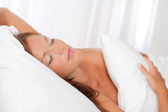 Beautiful woman sleeping in white bed Royalty Free Stock Photography
