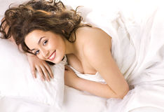 Beautiful woman sleeping in white bed Royalty Free Stock Photos