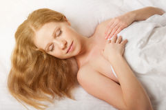 Beautiful woman sleeping in white bed net Royalty Free Stock Image