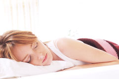 Beautiful woman sleeps. Beautiful woman sleep on the white background Royalty Free Stock Images