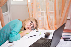 Beautiful woman sleeps with papers Royalty Free Stock Images