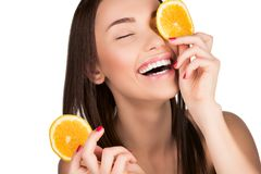 Woman with sliced orange. Beautiful woman with sliced orange for skincare mask for mask isolated on white stock image