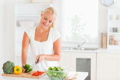 Beautiful woman slicing pepper Stock Photo