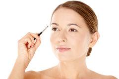 Beautiful woman with a small cosmetics brush Stock Photo