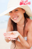 Beautiful woman with small crab in her palms Royalty Free Stock Image