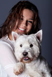 Beautiful woman with small dog Stock Photography