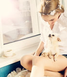 Beautiful woman with small dog Stock Image