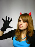 Beautiful woman with small horns on a head Stock Photography