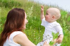 Beautiful woman with small kid royalty free stock images