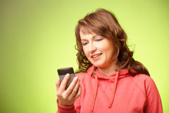 Beautiful woman with smartphone Royalty Free Stock Image