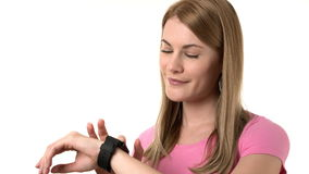 Beautiful woman with smartwatch. Browsing internet, communicating with friends. Isolated background. stock footage