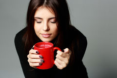 Beautiful woman smelling the aroma of coffee Royalty Free Stock Photos