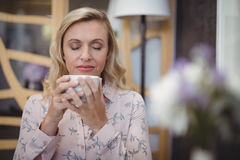 Beautiful woman smelling black coffee Stock Image