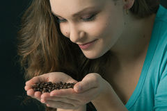 Woman smelling coffee beans Royalty Free Stock Photography