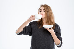 Beautiful woman smelling cup with coffee Royalty Free Stock Image