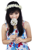 Beautiful woman smelling flower royalty free stock images