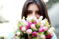 Beautiful woman smelling flowers Royalty Free Stock Images