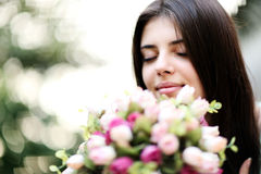 Beautiful woman smelling flowers Stock Image