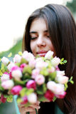 Beautiful woman smelling flowers Royalty Free Stock Photo